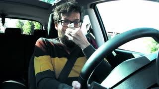 man-driving-car-sneezing.jpg