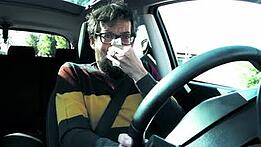 man-driving-car-sneezing.jpg